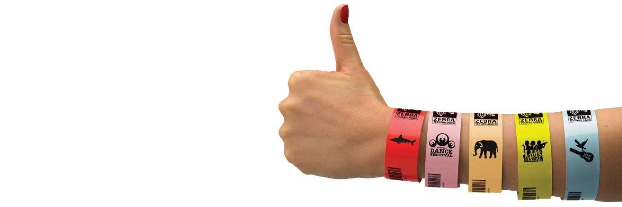Zebra event wristbands on wrist with hand giving thumbs up