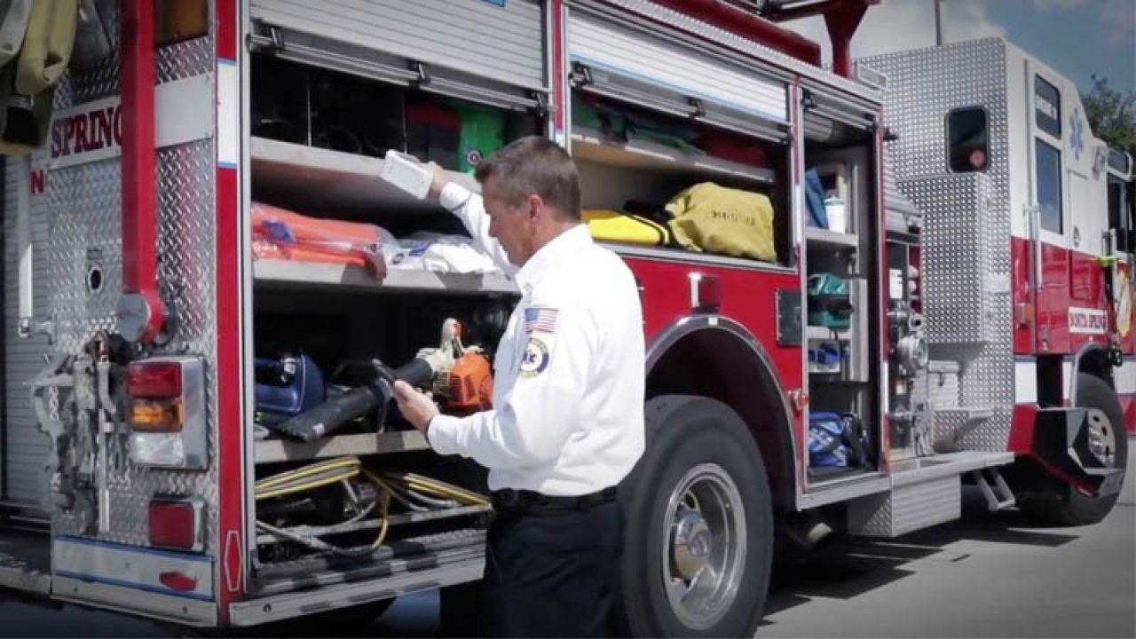 Bonita Springs Fire Control and Rescue District firefighter checking truck supplies