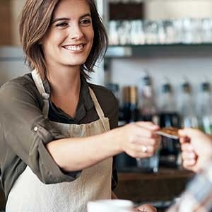 Quick Service Restaurant employee giving card back to customer